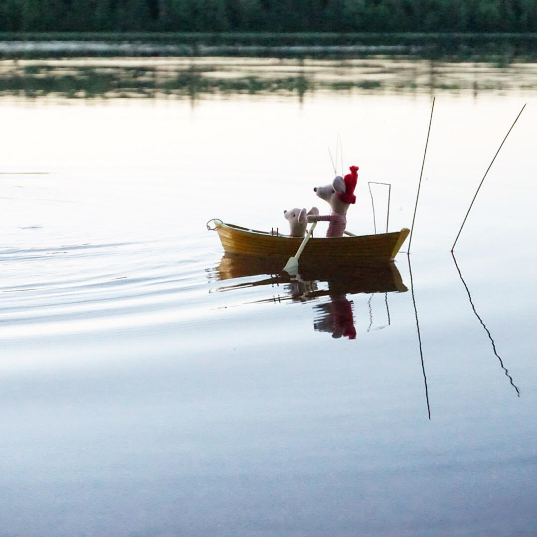 mouse and uncle rowing at sunset